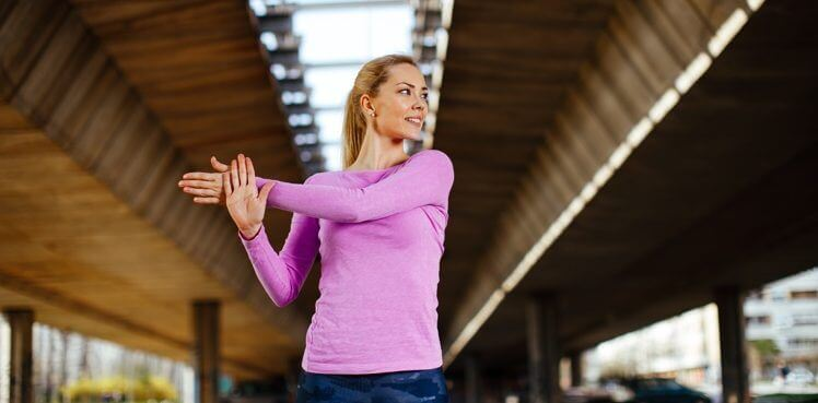 shoulderstretchacross e1492724585315 How to Make Your Shoulders Move Pain Free Again